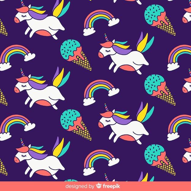 Hand drawn unicorn pattern Free Vector