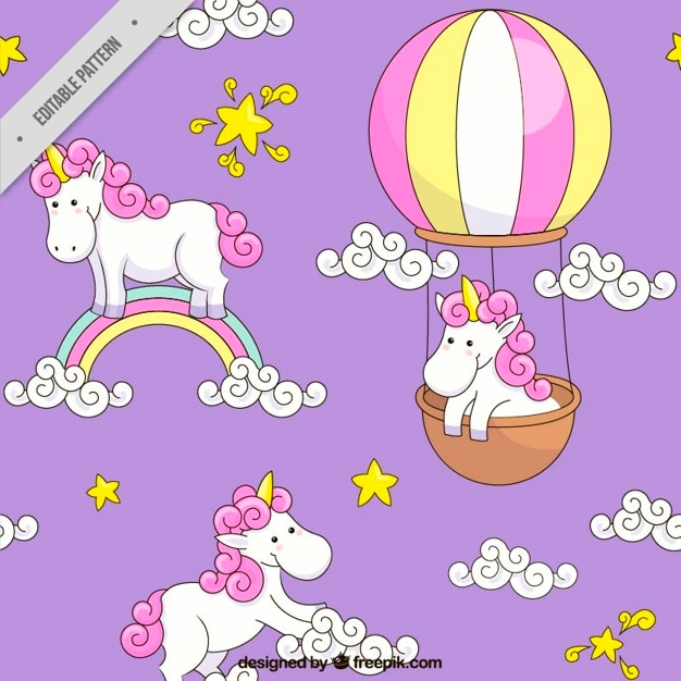 Hand drawn unicorn with rainbow and balloon  pattern Free Vector