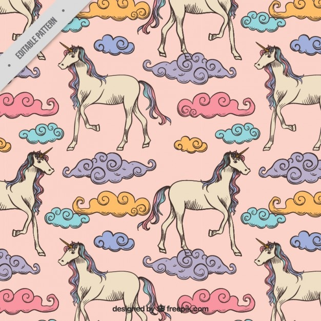 Hand drawn unicorns with colored clouds pattern Free Vector