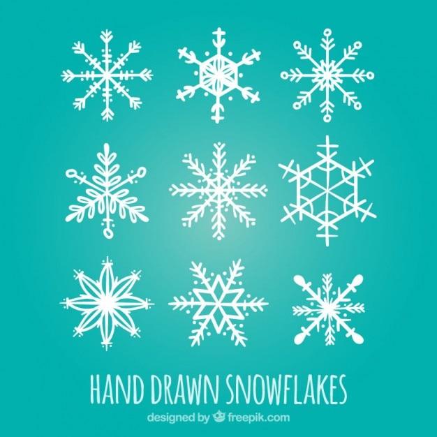 Hand drawn white snowflakes vector premium download