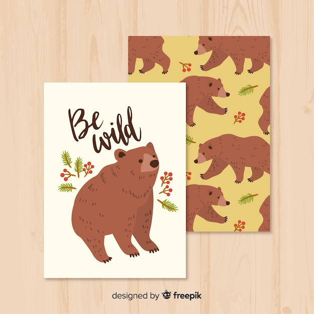 Hand drawn wild bear card in the nature Free Vector