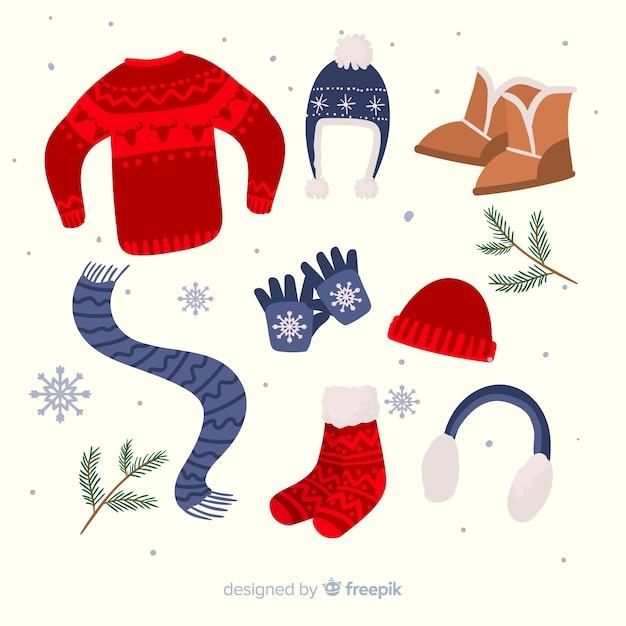Vestiti invernali ed elementi essenziali disegnati a mano Vettore gratuito