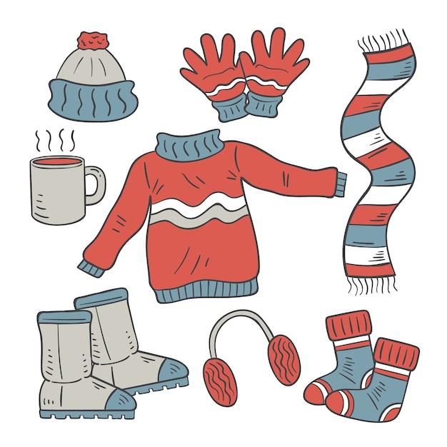 Abbigliamento invernale disegnato a mano ed elementi essenziali Vettore gratuito