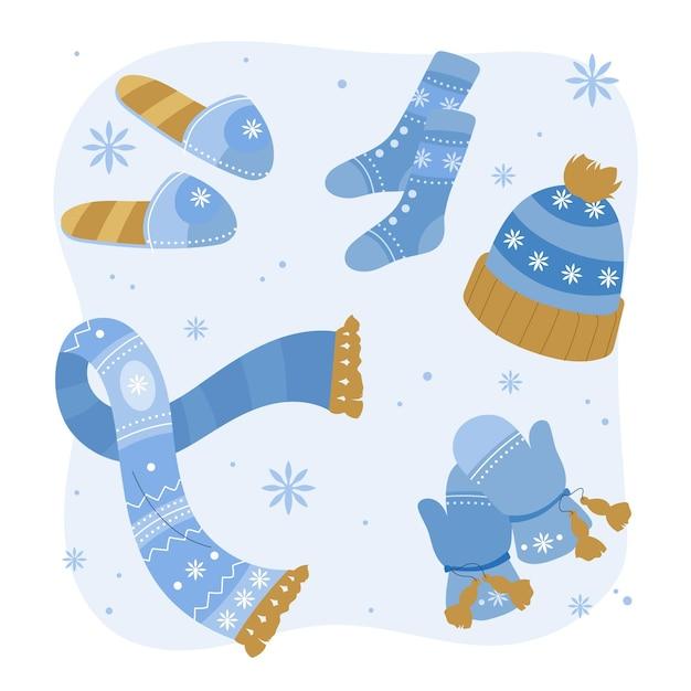 Abbigliamento invernale ed elementi essenziali disegnati a mano Vettore gratuito