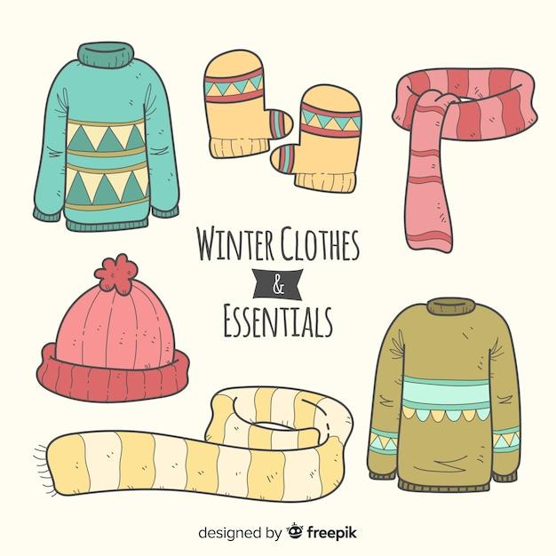 Collezione di elementi essenziali invernali disegnata a mano Vettore gratuito