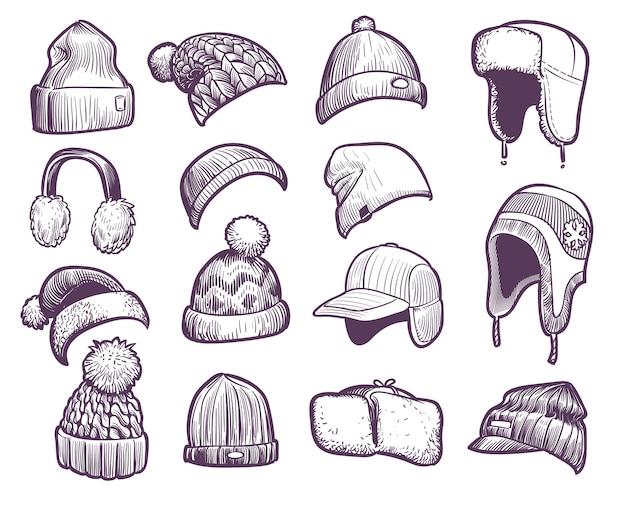 手描きの冬の帽子。ポンポンとイヤーフラップ付きのさまざまなニット帽のセット、フィッシャーマンビーニー、スポーツキャップの帽子のスケッチ暖かいクリスマスの毛皮のヘッドフォンとキャップのセット Premiumベクター