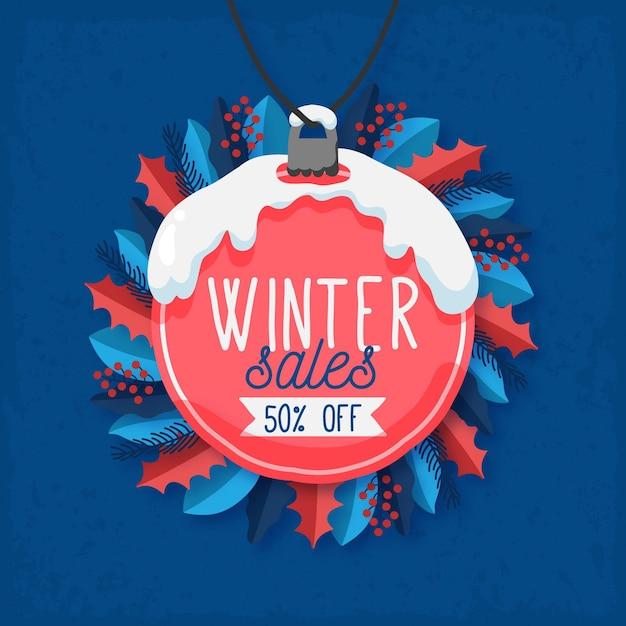 Saldi invernali disegnati a mano con palla di natale e vischio Vettore gratuito