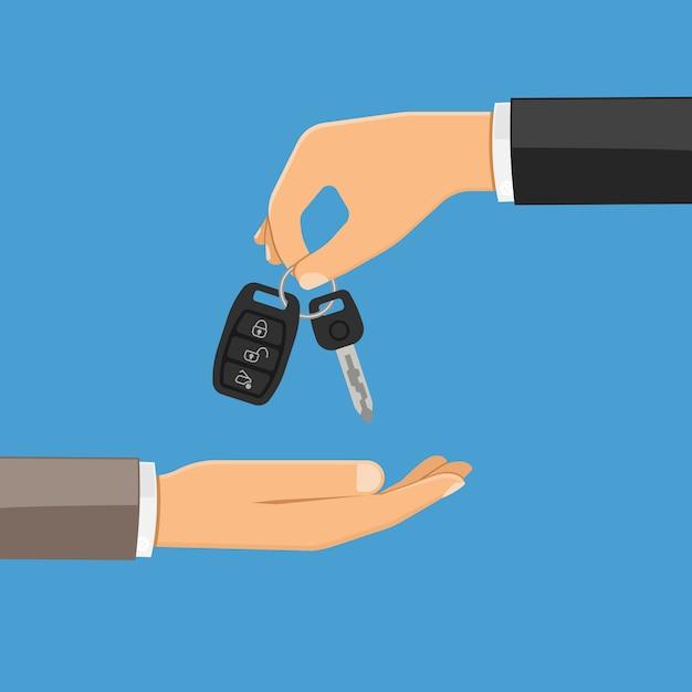 Hand giving car keys Premium Vector