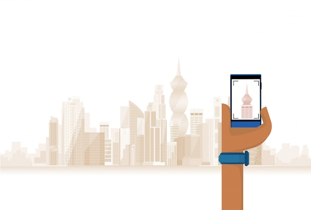 Hand hold cell smart phone taking photo of modern city Premium Vector