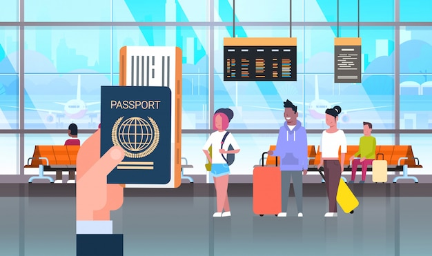 Hand hold passport and ticket over people in airport Premium Vector