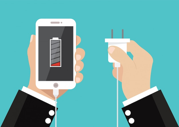 Hand hold smartphone and charge battery and plug. Premium Vector