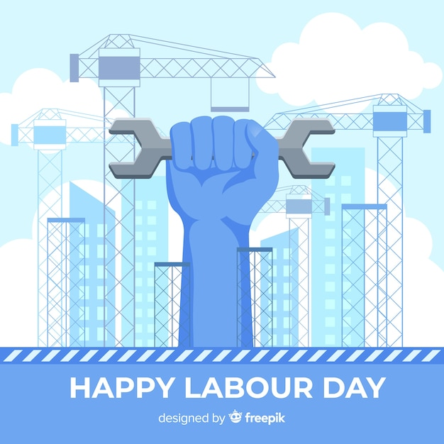 Hand holding adjustable wrench labor day background Free Vector