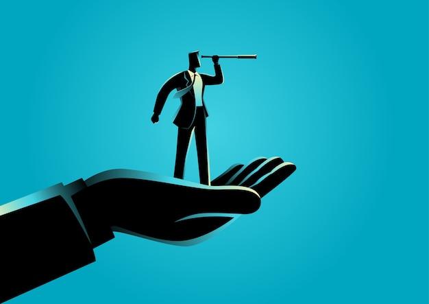 Hand holding a businessman using telescope Premium Vector