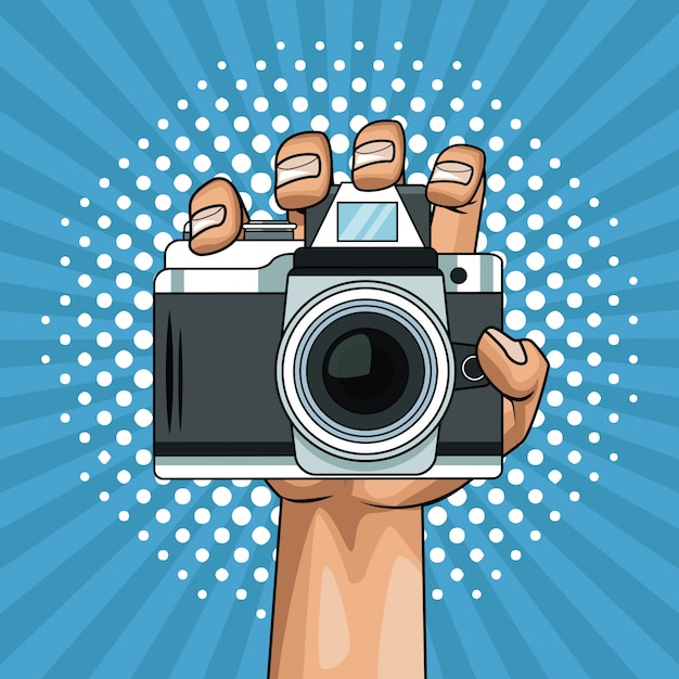 Hand holding camera pop art cartoon Premium Vector