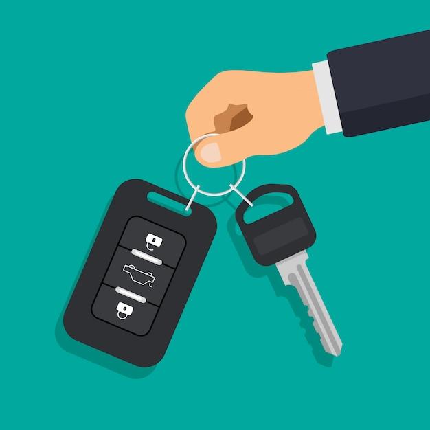 車のキーと警報システムの手。レンタカーや販売のコンセプト。 Premiumベクター