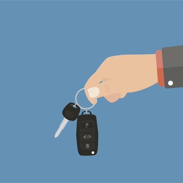 Hand holding car keys Free Vector