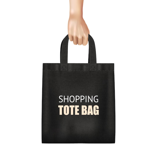 Hand holding fashionable black canvas shopping tote bag Free Vector