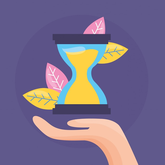 Hand holding hourglass Free Vector