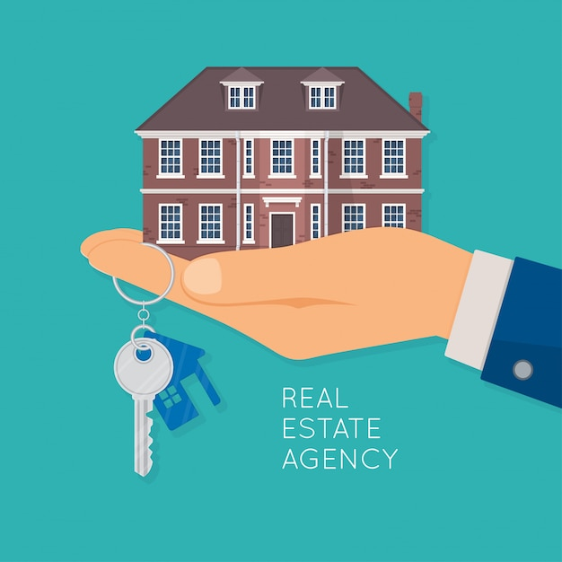 Hand holding house and key Premium Vector