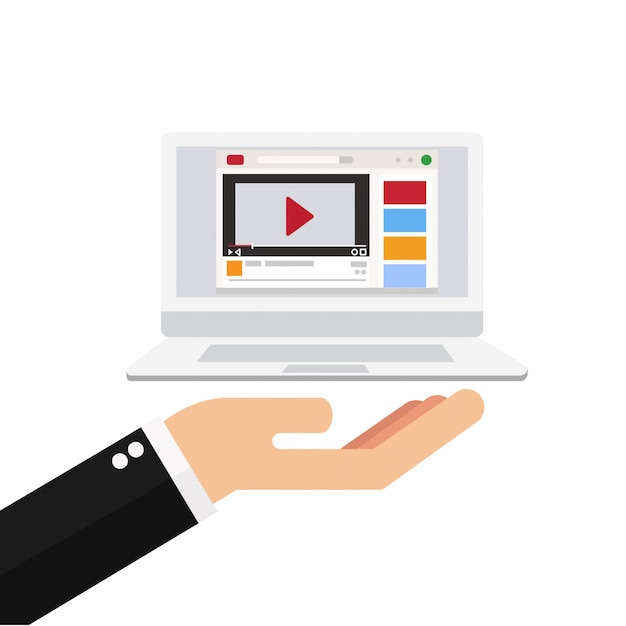 Hand holding laptop with video player Premium Vector