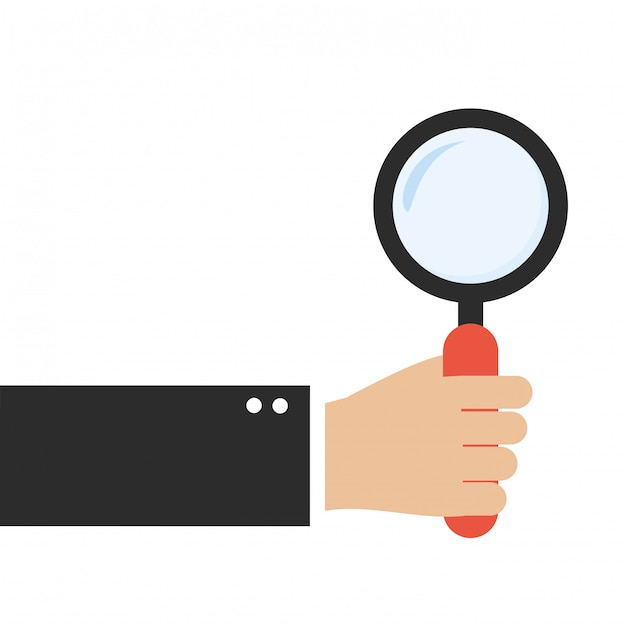 Hand holding magnifying glass Premium Vector