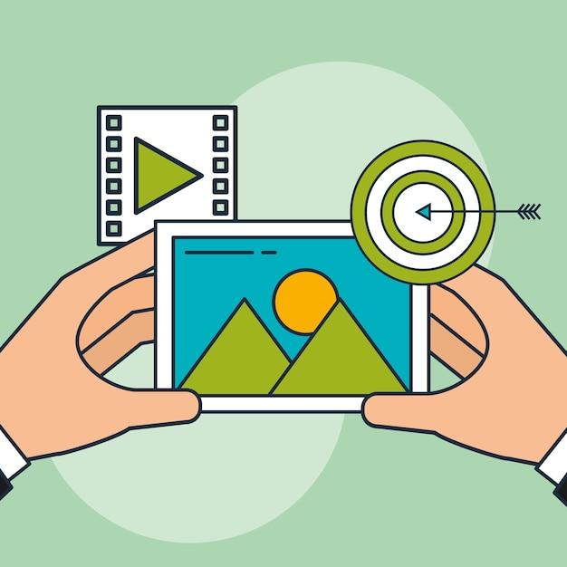 Hand holding photo and target video digital marketing Premium Vector