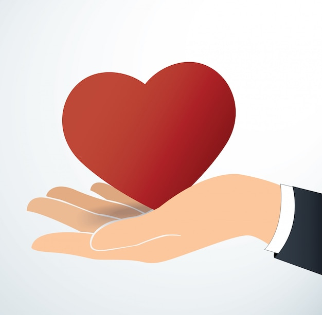 Hand holding the red heart Premium Vector