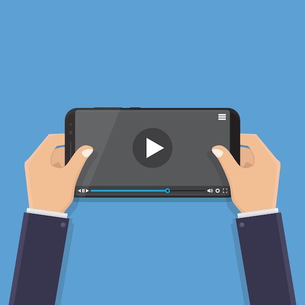 Hand holding smart phone, watching video, flat design vector illustration Premium Vector