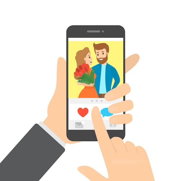 ハートボタンを押すアプリでスマートフォンと写真が好きな手。ソーシャルネットワークのアイデア。図 Premiumベクター