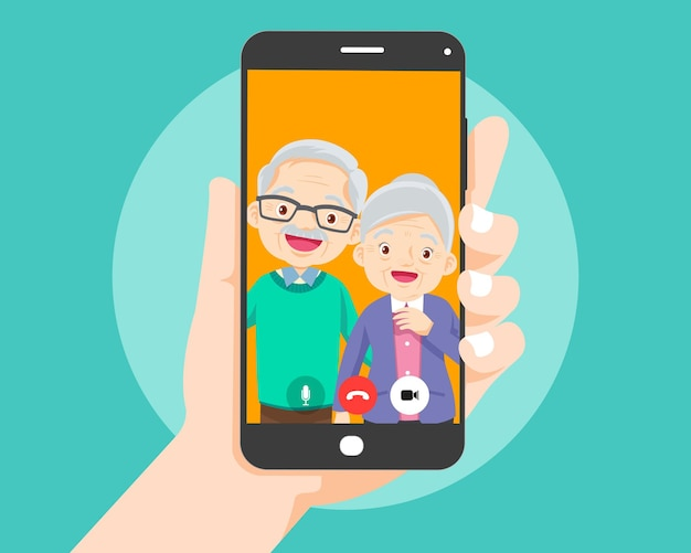 Hand holding smartphone with elderly couple on screen.video call with grandparents or aging parents.