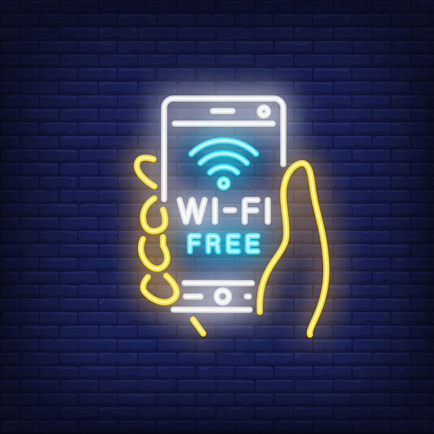 Hand holding smartphone with wi-fi free neon text Free Vector