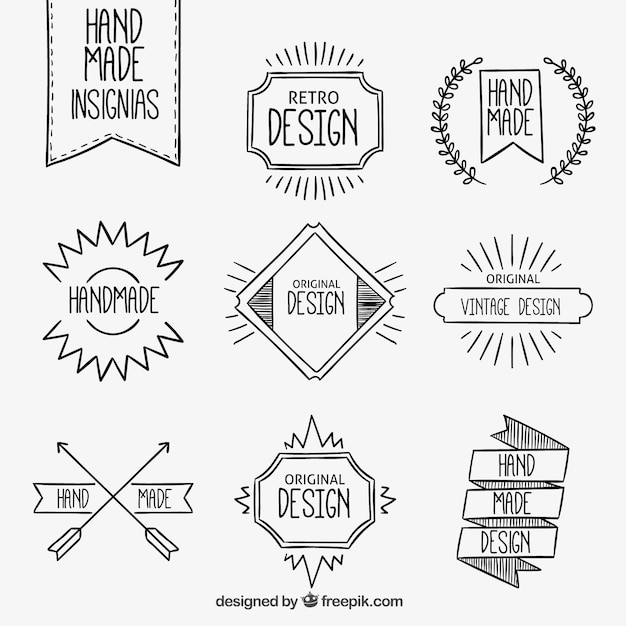 Hand made insignias Free Vector