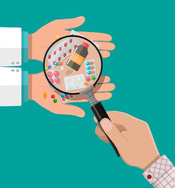 Рука фармацевта с таблетками и лекарствами Premium векторы