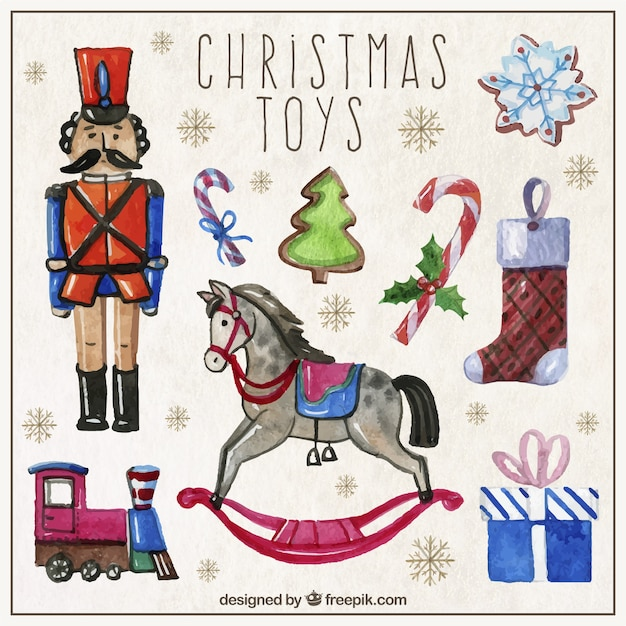 Hand painted christmas toys Free Vector