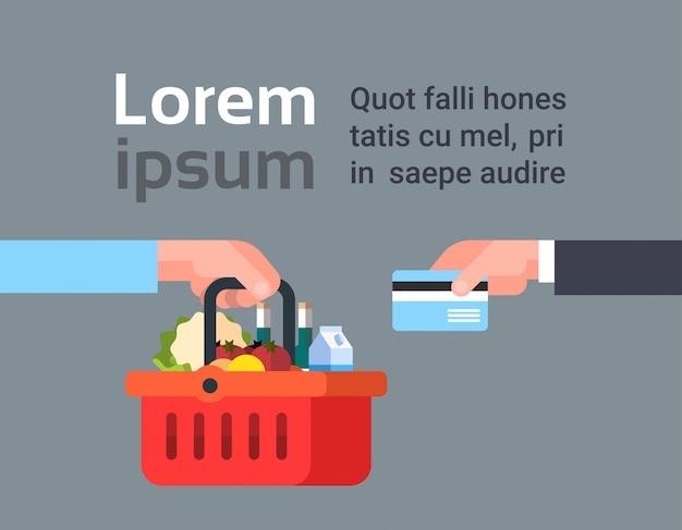 Hand paying for shopping basket of grocery products with credit card, online food order and delivery service concept Premium Vector