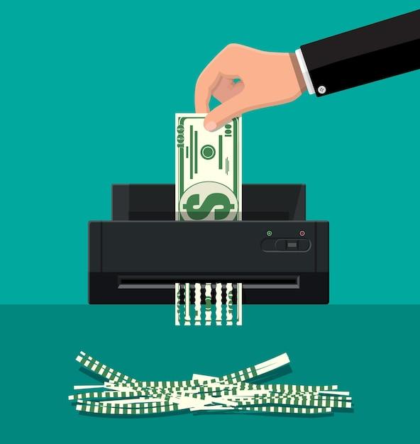 Рука положить долларовую банкноту в шредер. Premium векторы