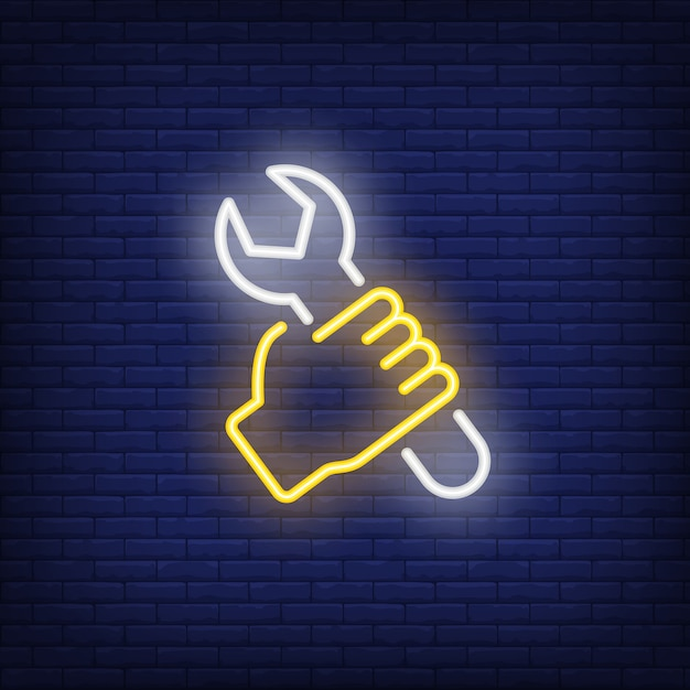 Hand with wrench neon sign Free Vector