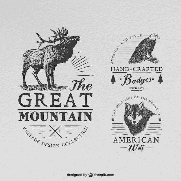 Handcrafted badges with animals Free Vector