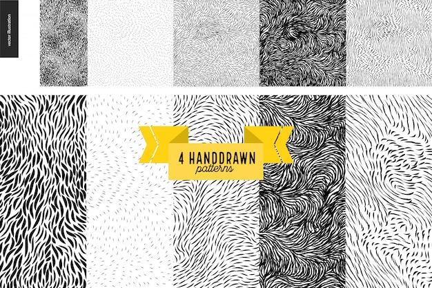Handdrawn black and white patterns set. fur or leaves seamless black and white patterns Premium Vector