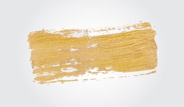 Золотая кисть ручной работы мазки краски Бесплатные векторы