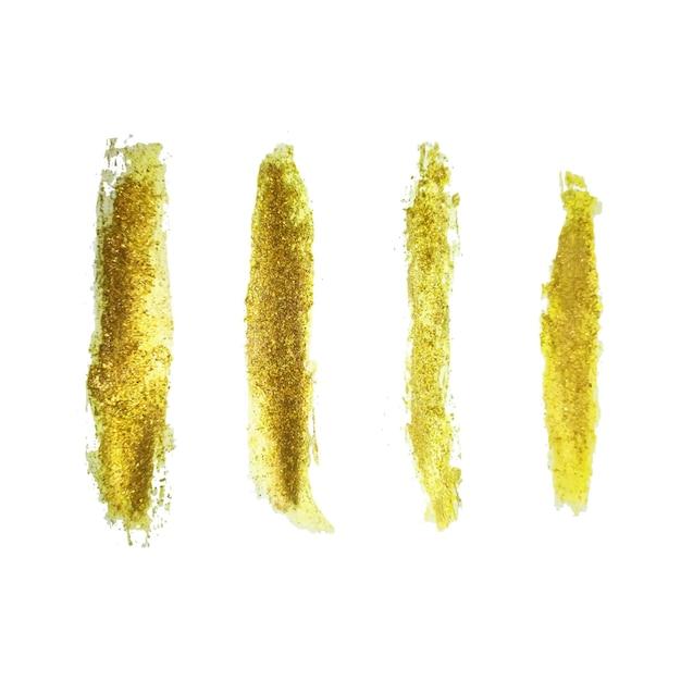 Набор мазков золотой кистью ручной работы Бесплатные векторы