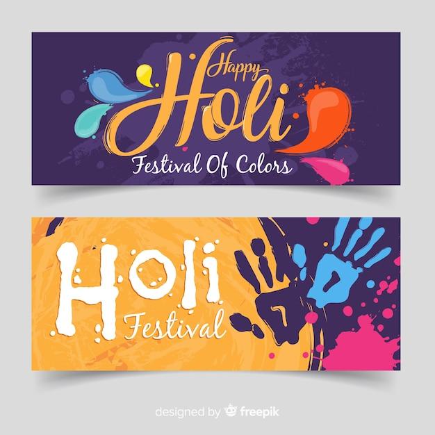 Handprint holi fesival banner Free Vector
