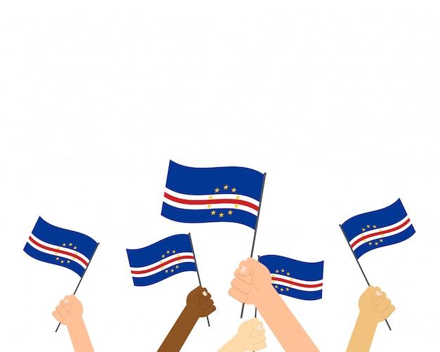 Hands holding cape verde flags Premium Vector