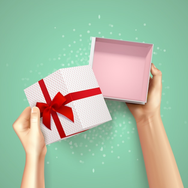 Hands holding gift box top view realistic background with square carton and red fillet with bow Free Vector