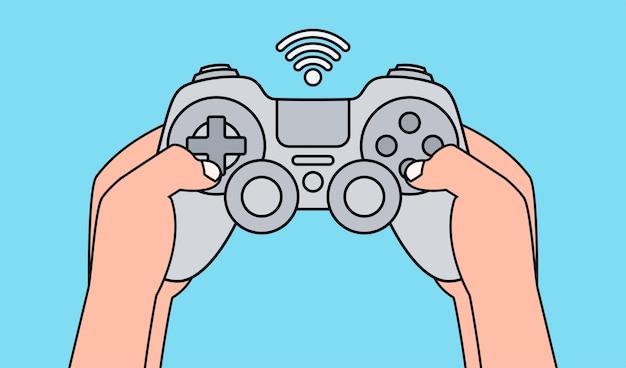 灰色のゲームパッドを押しながらビデオゲームをプレイする手。図。 Premiumベクター