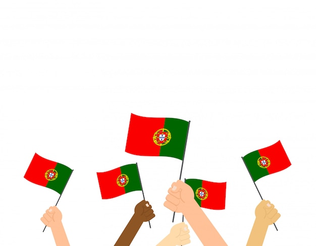 Hands holding portugal flags Premium Vector