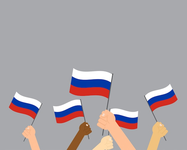 Hands holding russia flags isolated on gray background Premium Vector