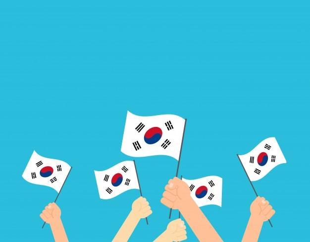Hands holding south korea flag Premium Vector