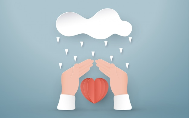 Hands protect the red heart. Premium Vector