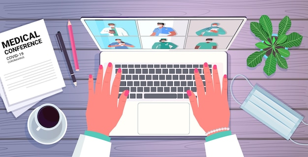ラップトップの医師を使用して手は、医療会議医学ヘルスケアオンライン通信の概念水平肖像画ベクトル図を持っているスクリーン医師の混血の同僚と話し合っています Premiumベクター
